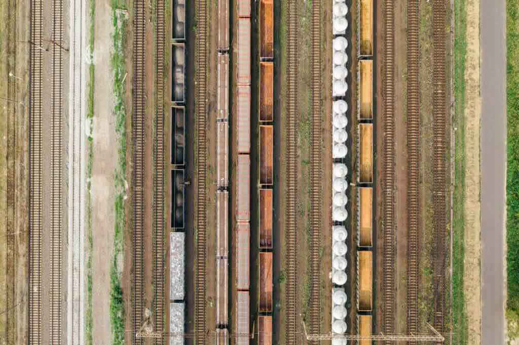 an aerial view of cargo trains